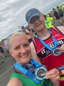 Katie Taggart and Pete Medlicott show off their medals