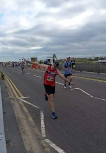 Darren Eckersley showboats on his way to a five minute PB.